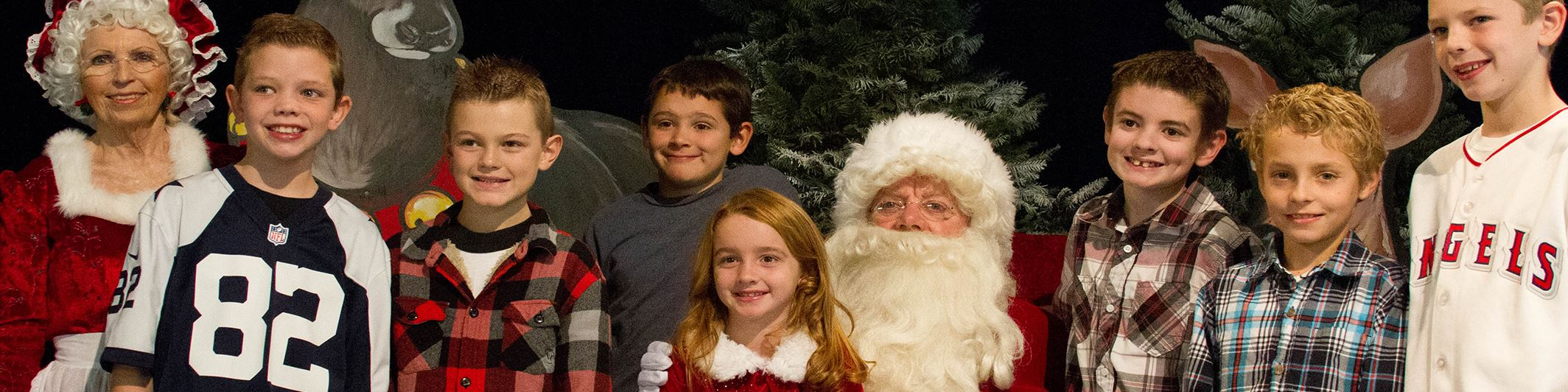 Children taking picture with Santa