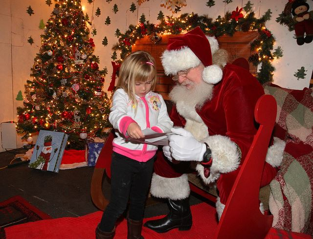 Santa reading book with girl